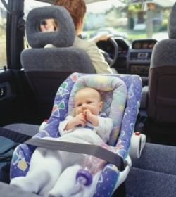 Child in carseat in car.