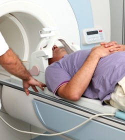 Person with head injury getting MRI who may need to contact an Atlanta traumatic brain injury lawyer