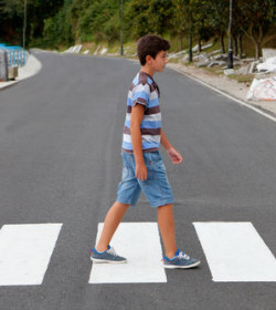 Boy in crosswalk that our Atlanta child pedestrian injury lawyer can represent if he is injured in a pedestrian accident.