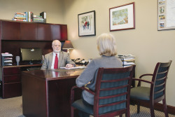 Atlanta personal injury lawyer Jim Poe talks to a client