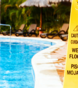 slip and fall accident sign near swimming pool